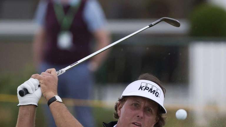Phil Mickelson plays out of a bunker by