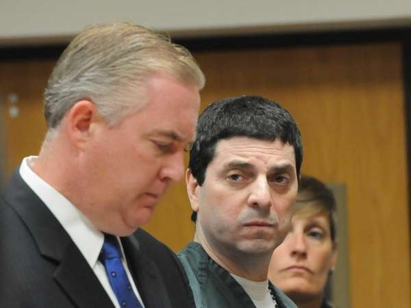 James O'Donnell, center, of Centereach, pleads guilty to