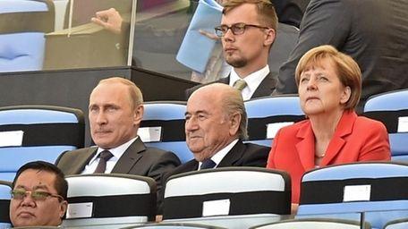 Russia's President Vladimir Putin, left, FIFA President Sepp