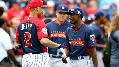 Derek Jeter of the Yankees greets Dee Gordon