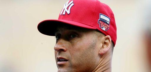 Derek Jeter of the Yankees looks on during
