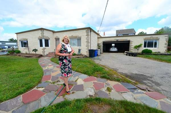 Dorothy Benjamin in front of her house in