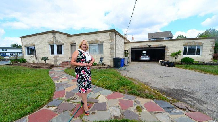 Dorothy Benjamin in front of her house in