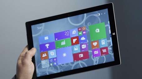 A Microsoft executive shows off the Surface Pro