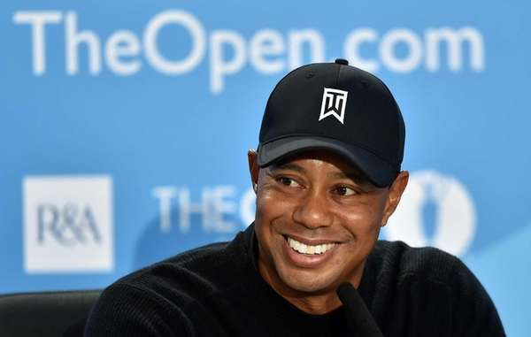 Tiger Woods smiles during a press conference at