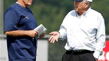 New England Patriots owner Robert Kraft, right, talks