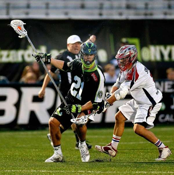 Matt Smalley #11 of the Boston Cannons checks
