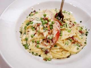 Lobster fettuccine carbonara is served at the Heirloom
