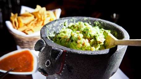 Guacamole is prepared table-side at Besito.