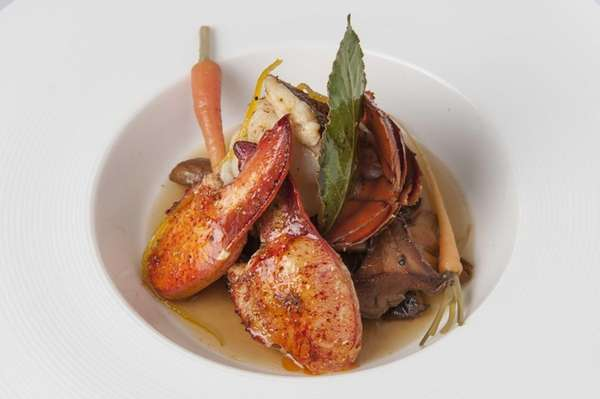 Spice-roasted lobster is served at the Topping Rose