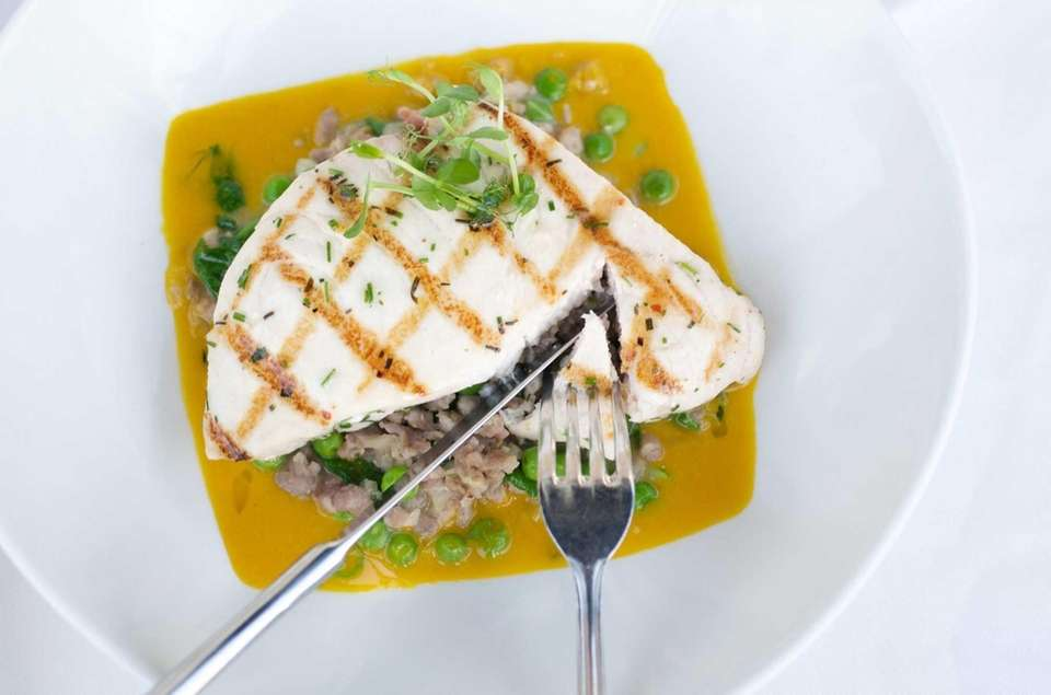 Grilled Montauk swordfish is served with sweet sausage