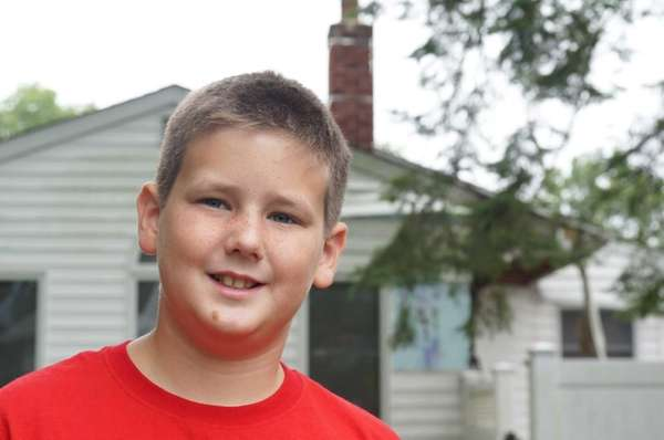 Christopher Schneider, 10, of Commack, who saw smoke