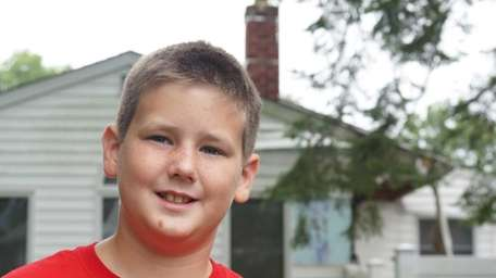 Christopher Schneider, 10, of Commack, who saw smoke
