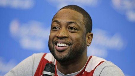 Miami Heat guard Dwyane Wade smiles as he