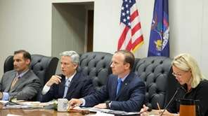 Islip Town Supervisor Tom Croci, center, presides over