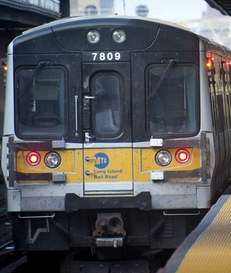 An LIRR conductor checks out his train while
