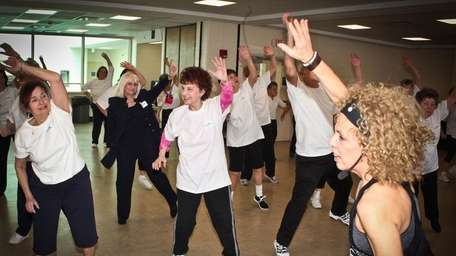 Seniors participate in a Zumba class through the