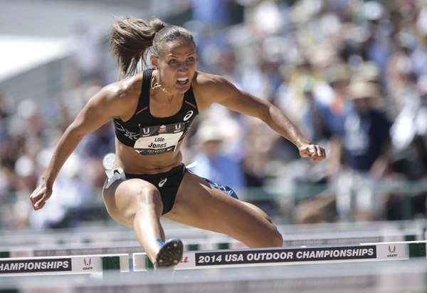 Lolo Jones, clears a hurdle in a semifinal