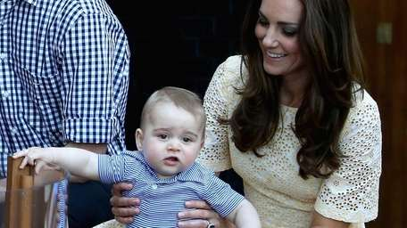 Catherine, Duchess of Cambridge, holds Prince George of
