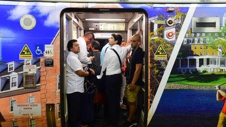 LIRR riders board a train during rush hour