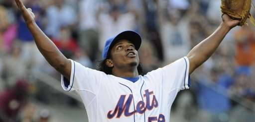 Mets pitcher Jenrry Mejia reacts after Miami Marlins'