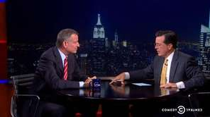 Bill de Blasio, left, with Stephen Colbert during