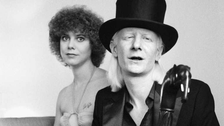 Guitarist Johnny Winter and his girlfriend Christine on