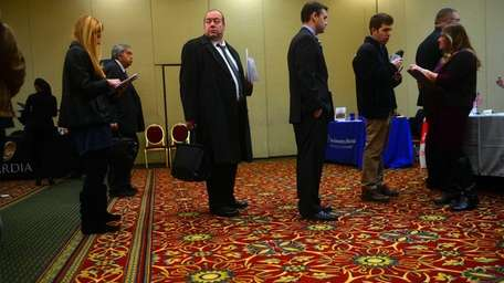Job seekers at a career fair at the