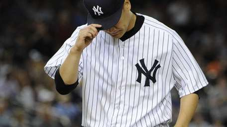 Yankees starting pitcher Masahiro Tanaka walks to the