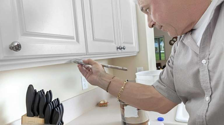 Painting kitchen cabinets can be a cost effective