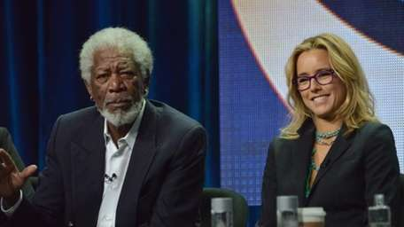 Morgan Freeman and Tea Leoni speak during the