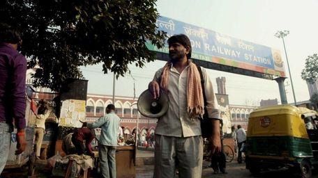 Rajesh Tailang as Mahendra Saini in front of
