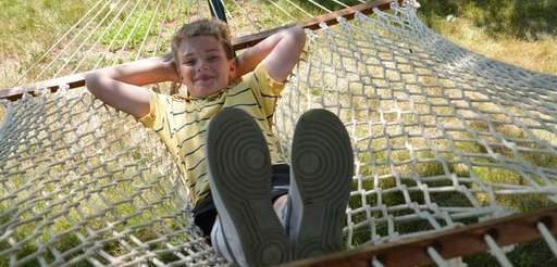 Ryan Blunden, 11, kicks back on the hammock