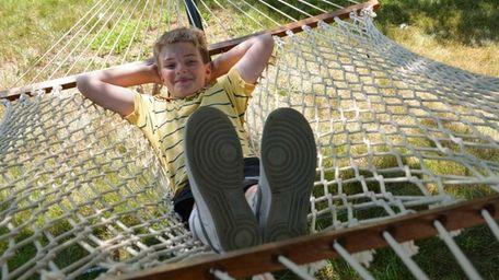Ryan Blunden, 11, kicks back on the hammock