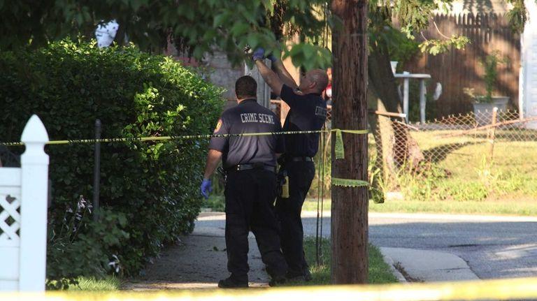 Police investigate the scene on Boylston Street where