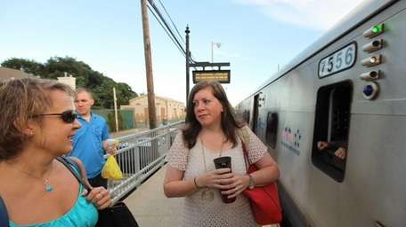 Commuters Christine Desanti, right, and Jeanne Yonkers, both