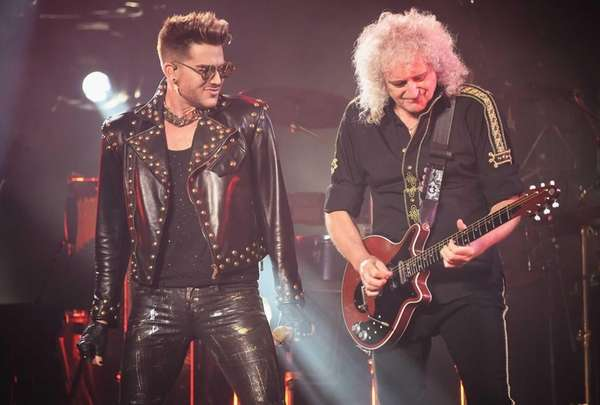 Singer Adam Lambert, left, performs with guitarist Brian
