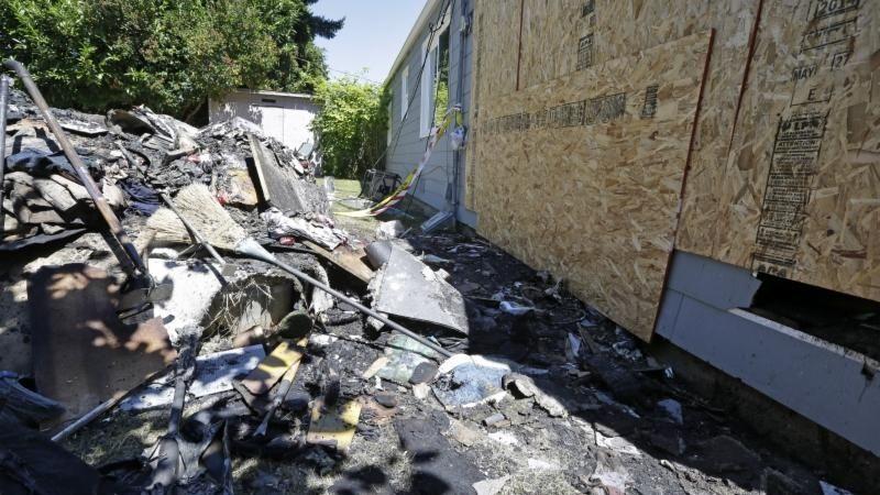 Debris from a fire fills the backyard next