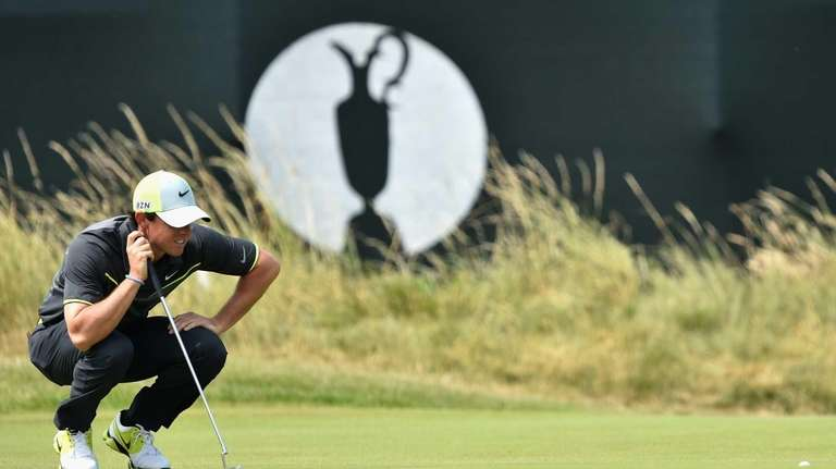 Rory McIlroy lines up a putt on the