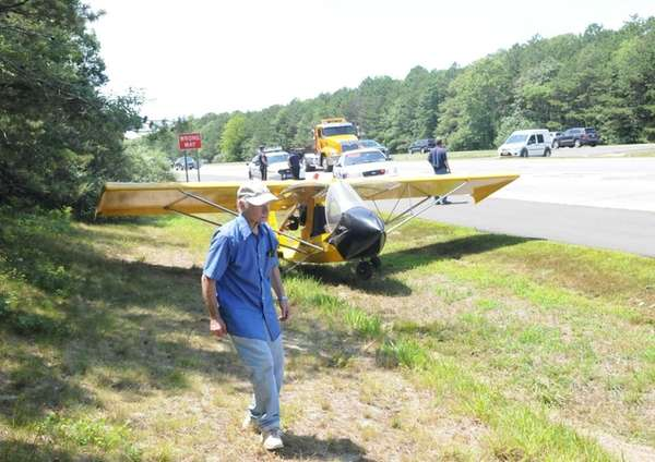 Pilot Frank Fierro walks next to his single-engine