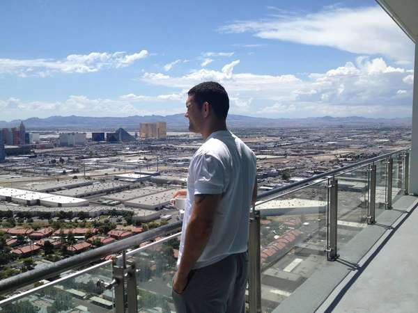 Chris Weidman looks at Las Vegas from his hotel room on the morning of his title defense against Lyoto Machida at UFC 175  on July 5, 2014.