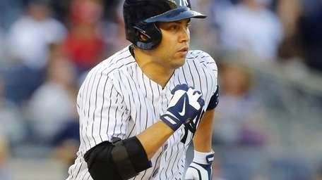 Carlos Beltran of the Yankees grounds out to
