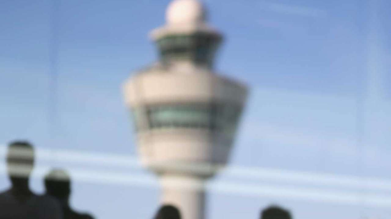 Members of the public view floral tributes adorning