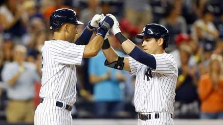 Jacoby Ellsbury of the Yankees celebrates his fifth-inning,
