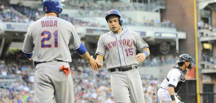 Travis d'Arnaud of the Mets is congratulated by