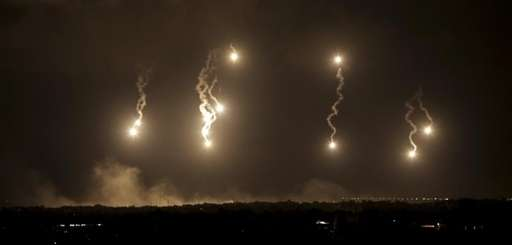 Israeli forces' flares light up the night sky