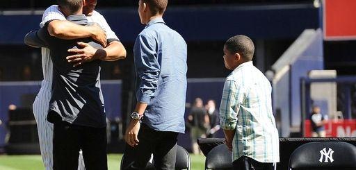 Mariano Rivera hugs his son Mariano Rivera Jr.