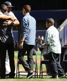 Mariano Rivera hugs his son Mariano Rivera Jr.