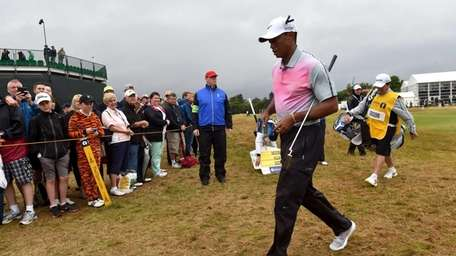US golfer Tiger Woods walks from a green