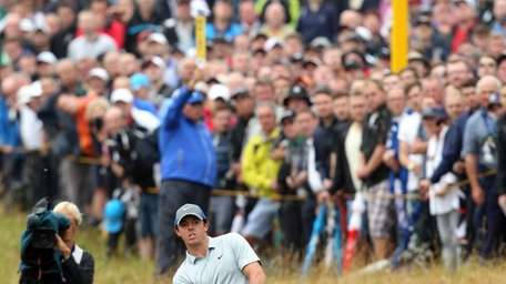 Northern Ireland's Rory McIlroy chips onto the 12th
